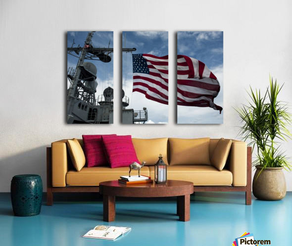 USS Cowpens flies a large American flag during a live fire weapons shoot. Split Canvas print