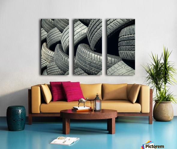 Tires stacked for recycling Split Canvas print