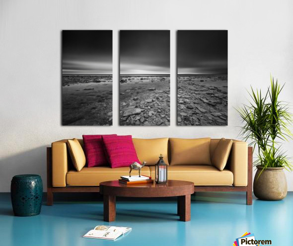 Dramatic sunset at a small bay and rocky beach Split Canvas print