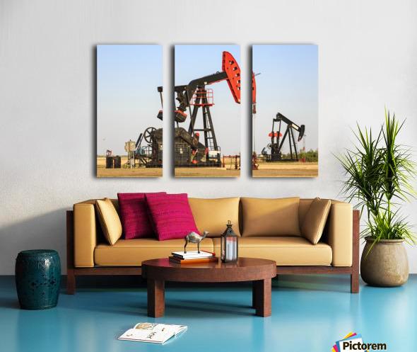 Oil well pump jacks at Bakken Oil Field near Estevan; Saskatchewan, Canada Split Canvas print