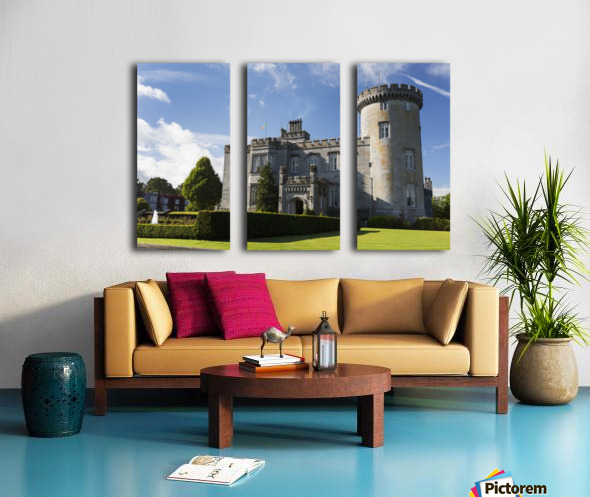 Stone castle with turret, manicured grass, gardens, fountain, blue sky and clouds; County Clare, Ireland Split Canvas print