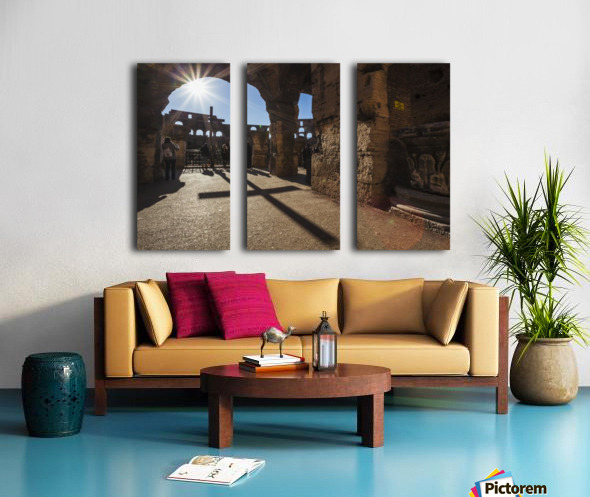 Sunburst through an archway at the Colosseum and a shadow of a cross; Rome, Italy Split Canvas print