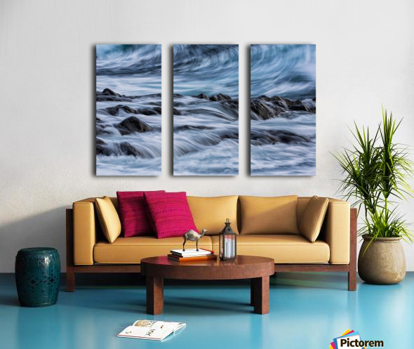 Long exposure of waves striking the coastline and flowing over rocks; Iceland Split Canvas print