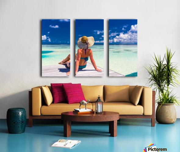 Sexy woman in bikini enjoy in tropical resort, sitting, back view Split Canvas print