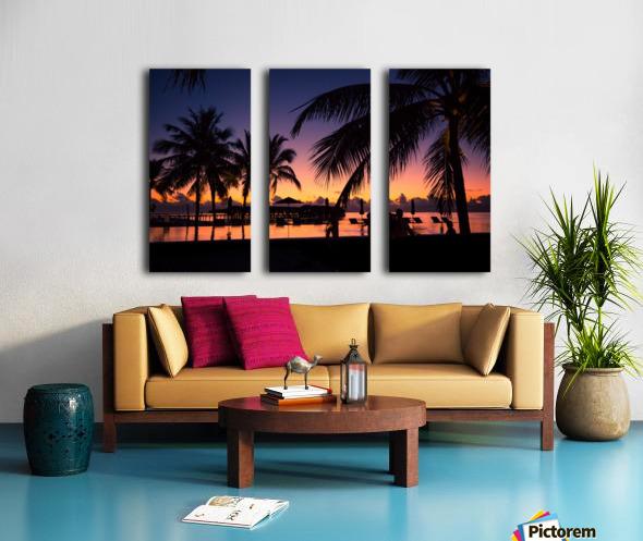 Silhouette coconut palm trees on beach at sunset. Vintage tone Split Canvas print