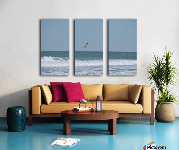 Seagull flying over waves Split Canvas print