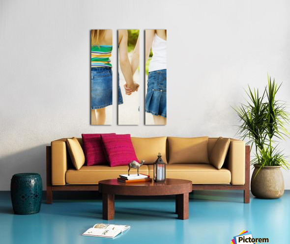 Rear View Of Girls Holding Hands Split Canvas print