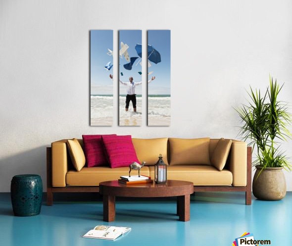 A Man Stands In The Ocean With Items From Work And Vacation Flying Over His Head; Tarifa, Cadiz, Andalusia, Spain Split Canvas print