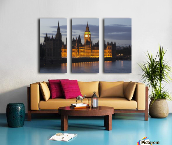 A Building And Clock Tower Along The Water's Edge Illuminated At Dusk; London, England Split Canvas print
