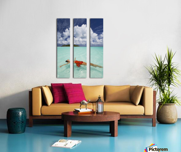French Polynesia, Woman Floating In Ocean Water. Split Canvas print