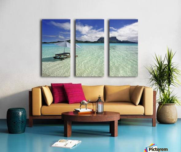 French Polynesia, Tahiti, Bora Bora, Picnic Table And Umbrella In Clear Lagoon Water. Split Canvas print