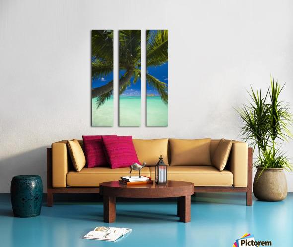 USA, Hawaii, Oahu, Palm tree over Pacific ocean with Mokulua island in background; Lanikai Split Canvas print