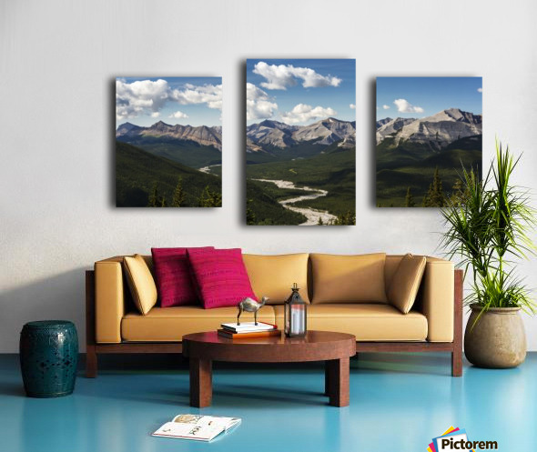 Panorama of river valley and mountain range with blue sky and clouds; Bragg Creek, Alberta, Canada Canvas print