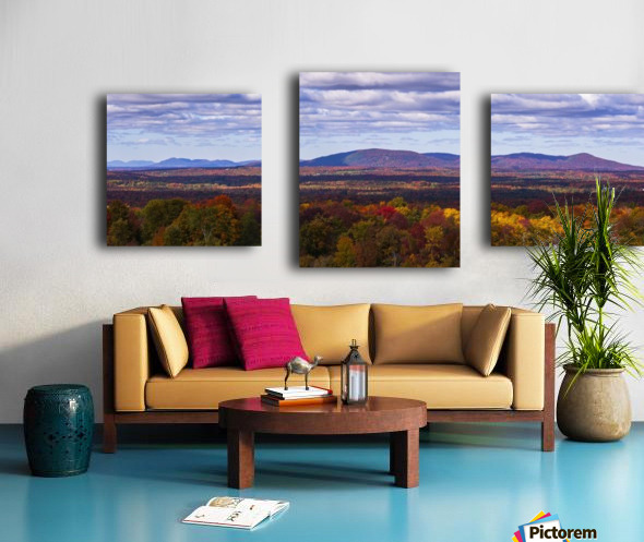 Mountain range in autumn colours with autumn coloured forest in the foreground; West Bolton, Quebec, Canada Canvas print
