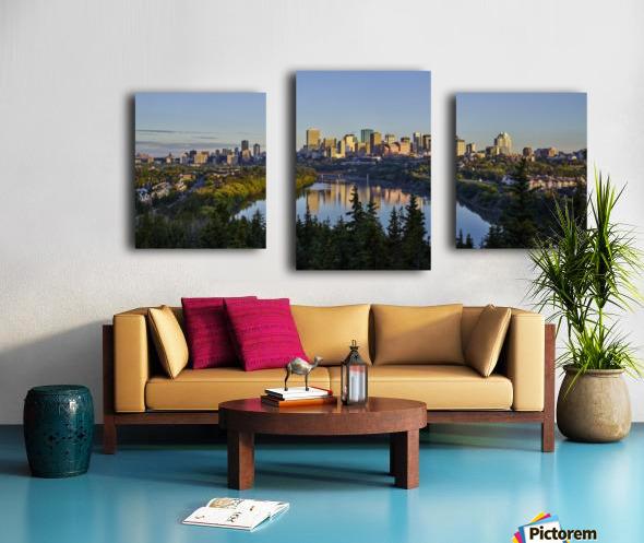 Skyline of downtown Edmonton reflected in the North Saskatchewan River under a blue sky; Edmonton, Alberta, Canada Canvas print