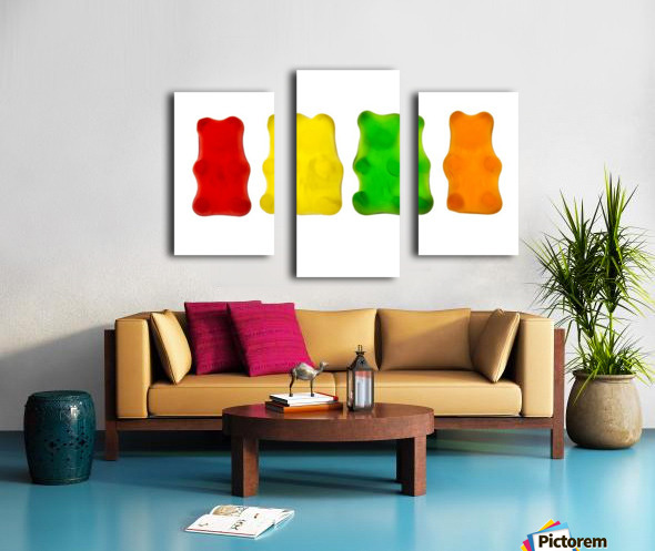 Colourful candied gummy bears in a row backlit; Calgary, Alberta, Canada Canvas print