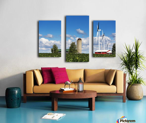 Large metal windmills in a farm yard with red barn and silo, soy bean field in the foreground and blue sky and clouds in the background; Ontario, Canada Canvas print