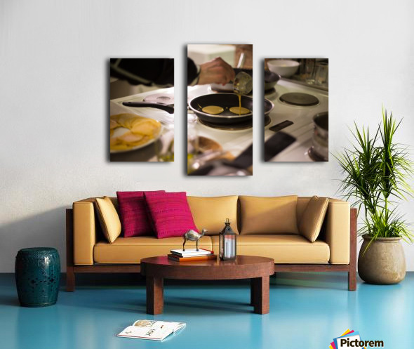Cooking pancakes in kitchen Canvas print