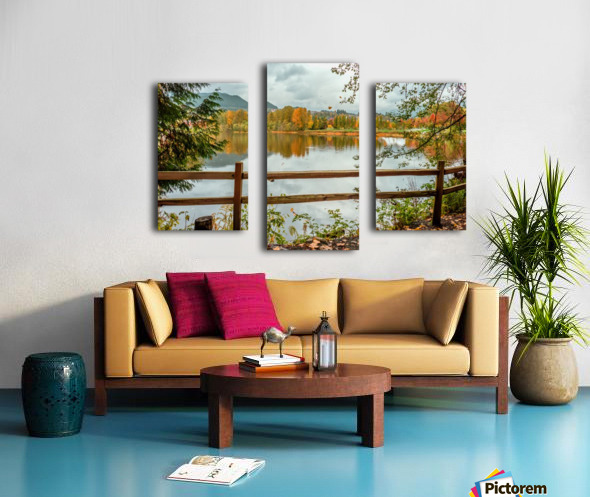 Wooden hedge blocks, falling autumn leaves, the water surface of the pond Canvas print