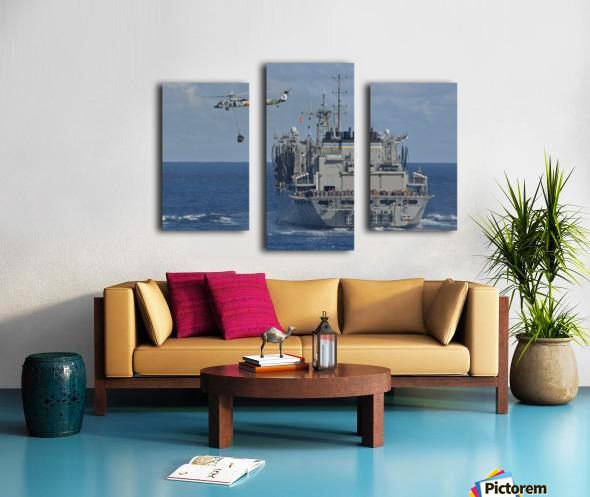 An MH-60S Sea Hawk conducts a vertical replenishment with USNS Bridge. Canvas print