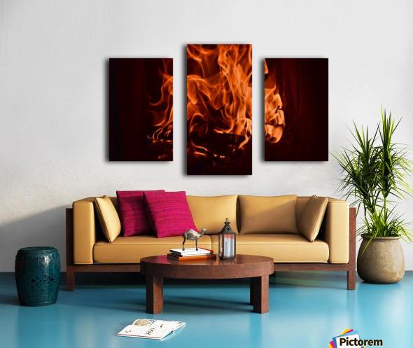 Fierce fire flames in the fireplace Canvas print
