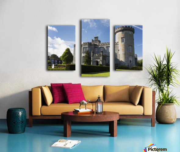 Stone castle with turret, manicured grass, gardens, fountain, blue sky and clouds; County Clare, Ireland Canvas print