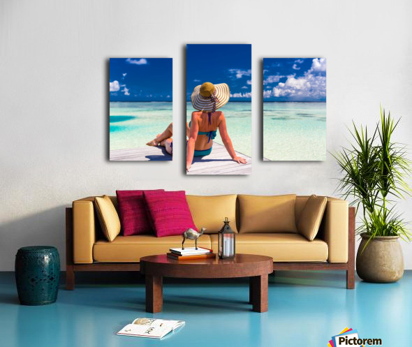 Sexy woman in bikini enjoy in tropical resort, sitting, back view Canvas print