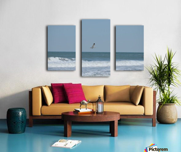 Seagull flying over waves Canvas print
