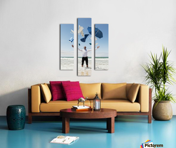 A Man Stands In The Ocean With Items From Work And Vacation Flying Over His Head; Tarifa, Cadiz, Andalusia, Spain Canvas print