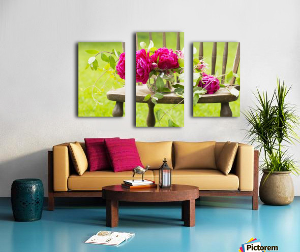Fresh pink peonies picked and lying on a wooden chair; New Westminster, British Columbia, Canada Canvas print