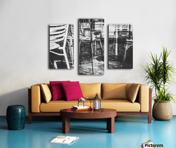 outdoor chairs in the city in black and white Canvas print