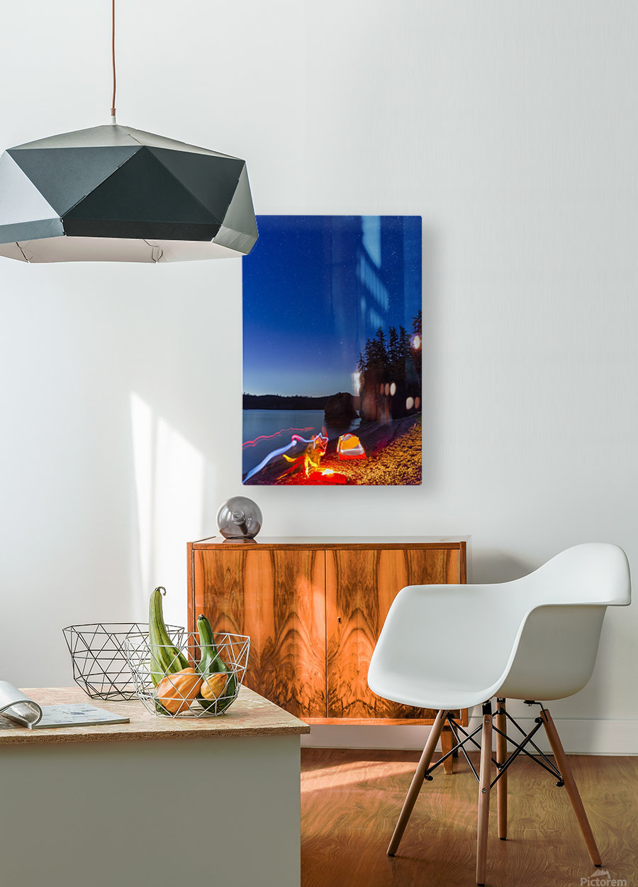 A campfire built on a beach at dusk next to a glowing tent and headlamp light trails, tranquil ocean water reflecting the warm light, Hesketh Island; Homer, Alaska, United States of America   HD Metal print with Floating Frame on Back