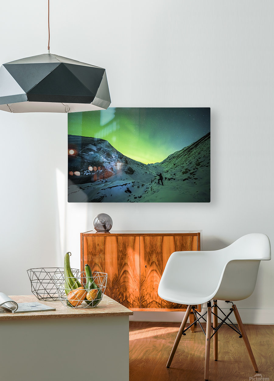 A man lights up the ice of Castner Glacier with a flashlight underneath a diffuse aurora display; Alaska, United States of America  HD Metal print with Floating Frame on Back