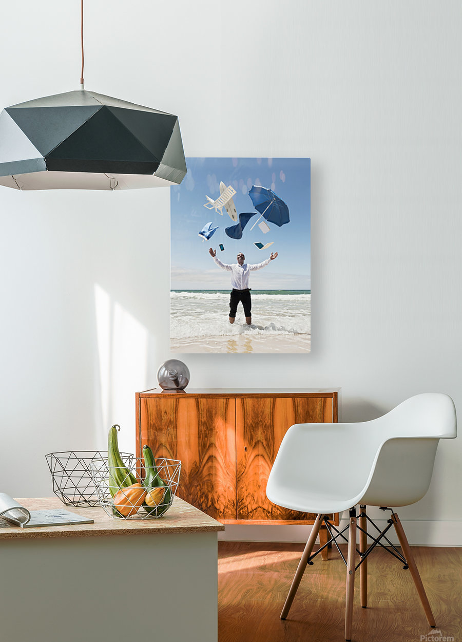A Man Stands In The Ocean With Items From Work And Vacation Flying Over His Head; Tarifa, Cadiz, Andalusia, Spain  HD Metal print with Floating Frame on Back