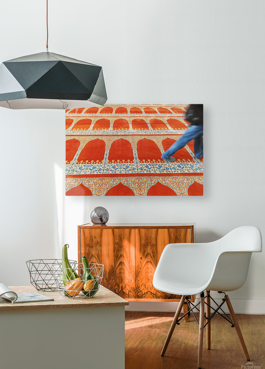 A person walking over the colourful carpet in the suleymaniye mosque;Istanbul turkey  HD Metal print with Floating Frame on Back