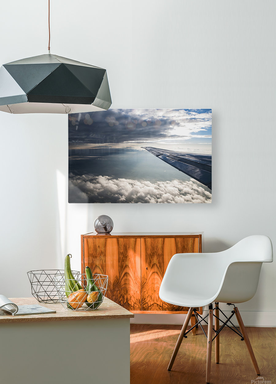 A commercial jet flies through the clouds; Colorado, United States of America  HD Metal print with Floating Frame on Back