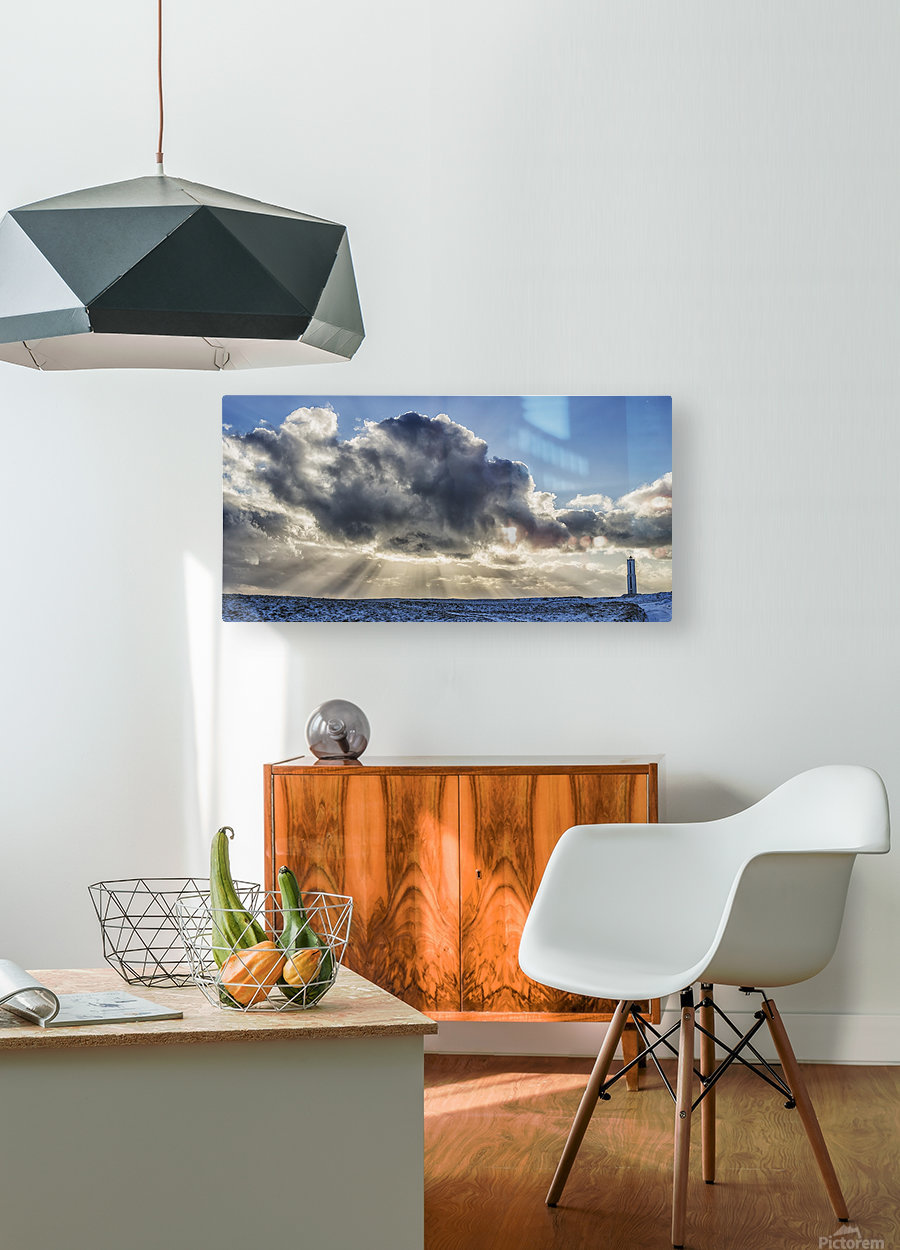 Rays of light shine out from behind the clouds in the skies above a lightnouse along the southern shore of Iceland; Iceland  HD Metal print with Floating Frame on Back