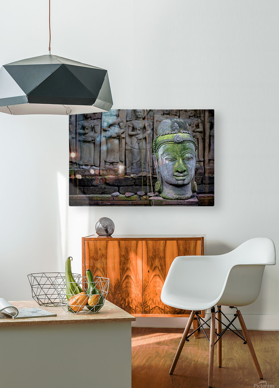 A terra cotta head of buddha sits in front of bas-relief in a terra cotta garden; Chiang Mai, Thailand  HD Metal print with Floating Frame on Back