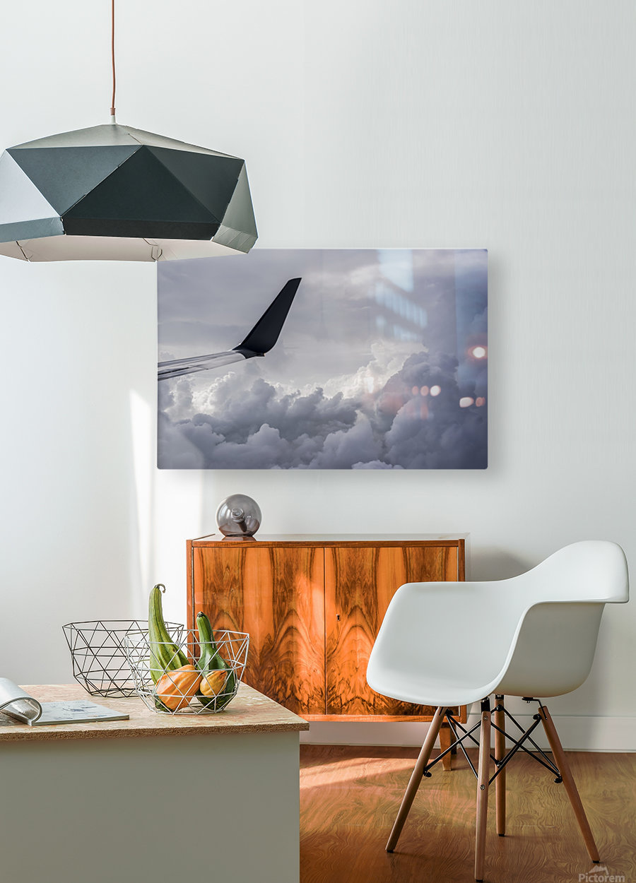 A commercial jet flies above the clouds over Illinois; United States of America  HD Metal print with Floating Frame on Back