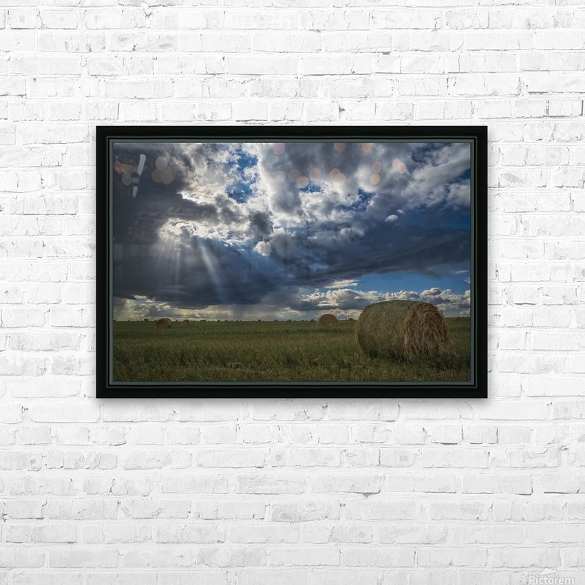 Sunlight breaks through the storm clouds over a field of hay bales; Saskatchewan, Canada HD Sublimation Metal print with Decorating Float Frame (BOX)