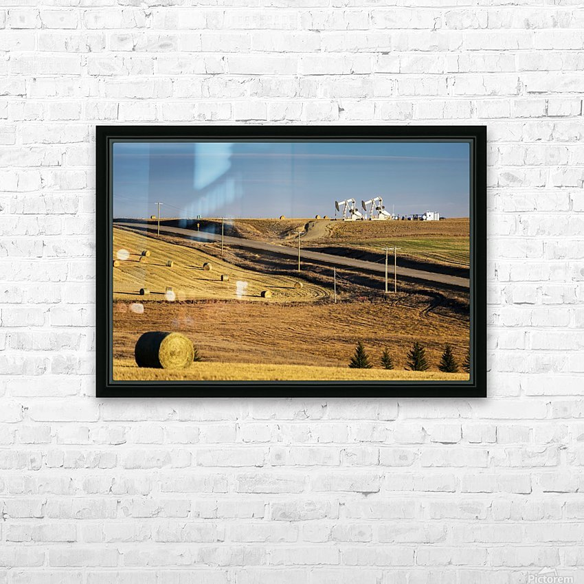 Two pump jacks on rolling hills in the distance along highway with cut fields and hay bales; Alberta, Canada HD Sublimation Metal print with Decorating Float Frame (BOX)