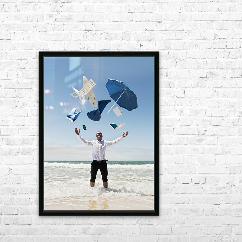 A Man Stands In The Ocean With Items From Work And Vacation Flying Over His Head; Tarifa, Cadiz, Andalusia, Spain HD Sublimation Metal print with Decorating Float Frame (BOX)
