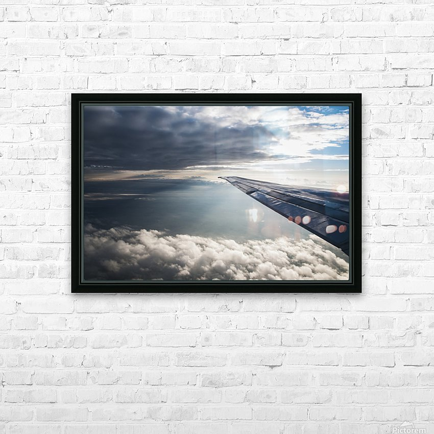 A commercial jet flies through the clouds; Colorado, United States of America HD Sublimation Metal print with Decorating Float Frame (BOX)