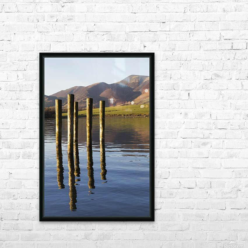 Wooden posts reflected in tranquil after with mountains the the background; Keswick, Cumbria, England HD Sublimation Metal print with Decorating Float Frame (BOX)