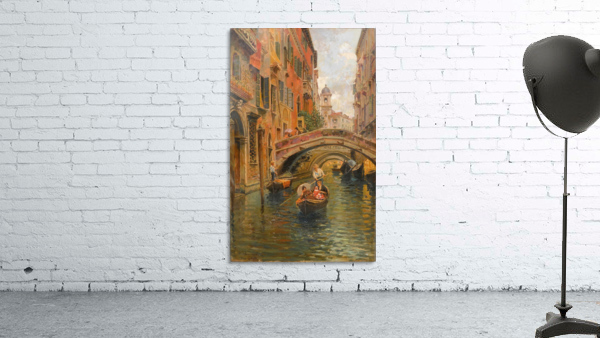 A walk with the gondola along a small canal in Venice