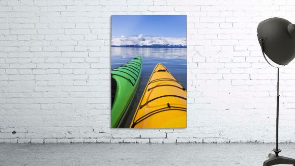 Kayakers enjoy a tranquil morning paddle in Lynn Canal, Alaska, near Juneau. Chilkat Mountains beyond.