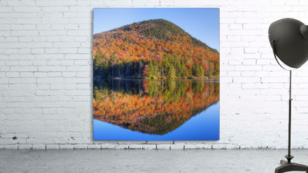 Mountain reflected in Sugarloaf pond in autumn; Quebec, Canada