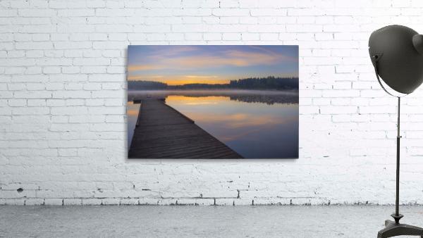 Reflection of a beautiful serene sunrise on peaceful Scott lake; Washington, United States of America