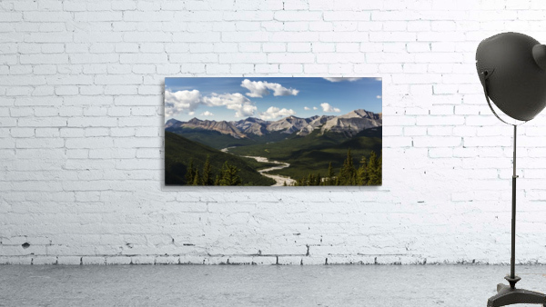 Panorama of river valley and mountain range with blue sky and clouds; Bragg Creek, Alberta, Canada