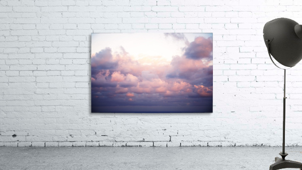 Cumulous pink clouds over horizon; Aina Haina, Oahu, Hawaii, United States of America